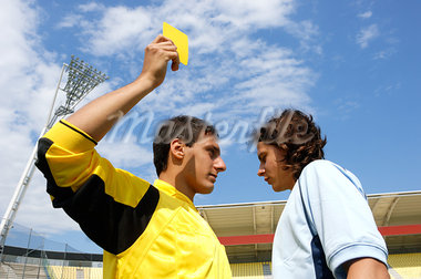 Referee showing yellow card to disappointed player Stock Photo - Premium Royalty-Freenull, Code: 622-00701504