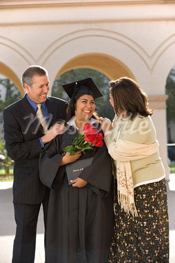 Family at Graduation    Stock Photo - Premium Rights-Managed, Artist: Tim Mantoani, Code: 700-00897785