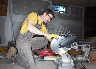 Man Using Saw    Stock Photo - Premium Rights-Managed, Artist: Jerzyworks, Code: 700-00933523