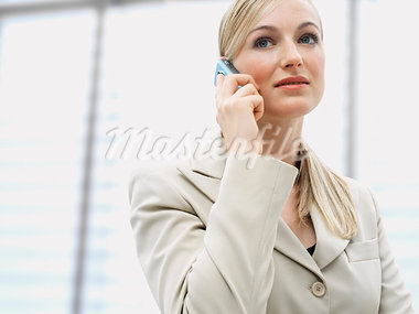 Businesswoman Using Cellular Phone    Stock Photo - Premium Rights-Managed, Artist: Huber-Starke, Code: 700-00954845