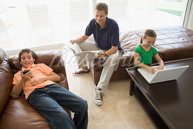 Family doing separate activities Stock Photo - Premium Royalty-Freenull, Code: 614-00966915