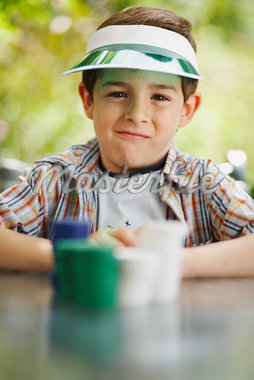 Boy with Stacks of Poker Chips    Stock Photo - Premium Royalty-Free, Artist: Masterfile, Code: 600-01073517