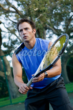 Man Playing Tennis    Stock Photo - Premium Rights-Managed, Artist: Tim Kiusalaas, Code: 700-01112455