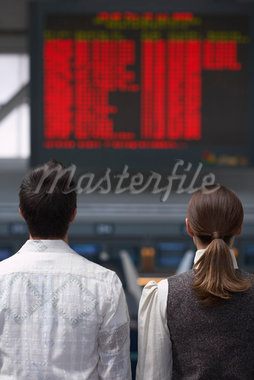 People Looking at Sign in Airport    Stock Photo - Premium Royalty-Free, Artist: Masterfile, Code: 600-01124865