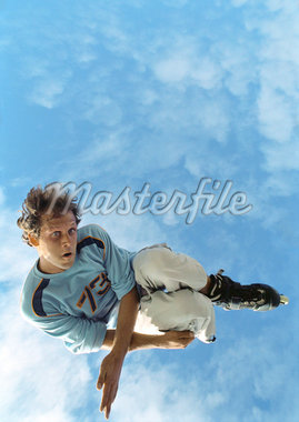 Young man on rollerblades, jumping, mid-air, low angle. Stock Photo - Premium Royalty-Freenull, Code: 632-01144716