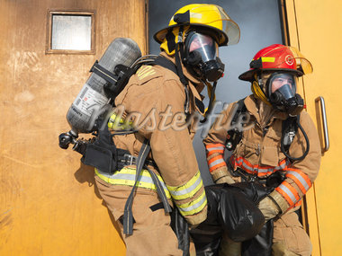 Firefighters Carrying Dummy out of Smoky Building    Stock Photo - Premium Royalty-Free, Artist: Masterfile, Code: 600-01172202
