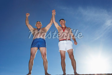 Swimmers With Medals, Cheering    Stock Photo - Premium Rights-Managed, Artist: Masterfile, Code: 700-01199313