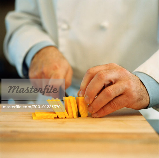 Chef Slicing Cheese    Stock Photo - Premium Rights-Managed, Artist: Derek Shapton, Code: 700-01223370