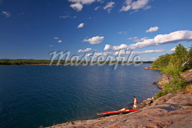 Man and Kayak by Shore, Philip Edward island, Georgian Bay, Ontario    Stock Photo - Premium Rights-Managed, Artist: Mike Randolph, Code: 700-01224341