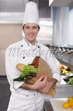 Chef Holding Bag of Food    Stock Photo - Premium Rights-Managed, Artist: Masterfile, Code: 700-01275224
