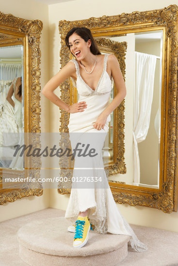 Portrait of Woman in Bridal Boutique Wearing Wedding Dress and Sneakers