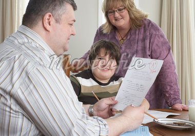 Parents Looking at Son's School Test    Stock Photo - Premium Rights-Managed, Artist: Masterfile, Code: 700-01345046