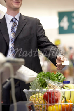 Man Paying For Groceries    Stock Photo - Premium Rights-Managed, Artist: Noel Hendrickson, Code: 700-01345687
