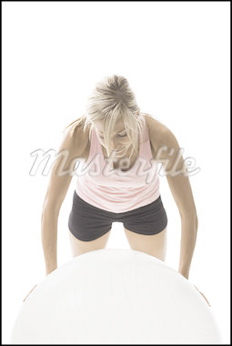 Close-up of a young woman exercising on a fitness ball Stock Photo - Premium Royalty-Freenull, Code: 640-01355771