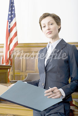 Portrait of a female lawyer standing in a courtroom Stock Photo - Premium Royalty-Freenull, Code: 640-01361771