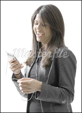 Close-up of a young woman looking at a portable video player Stock Photo - Premium Royalty-Freenull, Code: 640-01364224