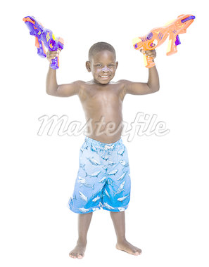 Boy with swim trunks and water pistols Stock Photo - Premium Royalty-Freenull, Code: 640-01365346
