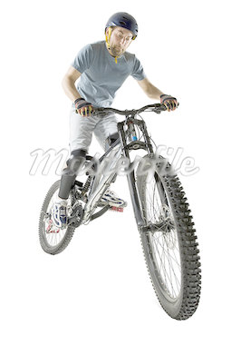 Low angle view of a young man riding a bicycle Stock Photo - Premium Royalty-Freenull, Code: 640-01365957