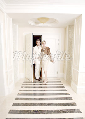 Mature couple entering a hotel suite Stock Photo - Premium Royalty-Freenull, Code: 644-01436107