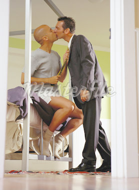 Couple Kissing in a Bedroom Stock Photo - Premium Royalty-Freenull, Code: 618-01440832