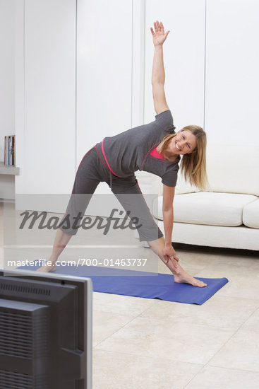 Woman Stretching    Stock Photo - Premium Rights-Managed, Artist: Masterfile, Code: 700-01463737