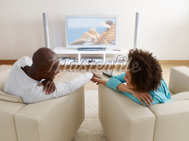 A couple holding hands in front of a television Stock Photo - Premium Royalty-Freenull, Code: 635-01489675