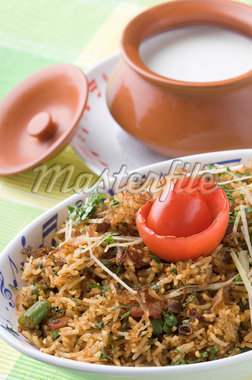 Close-up of a bowl of fried rice with a bowl of curd on a plate Stock Photo - Premium Royalty-Freenull, Code: 630-01491450