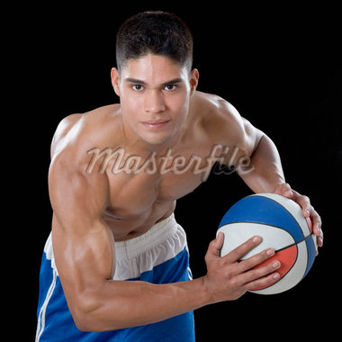 Portrait of a young man playing a basketball Stock Photo - Premium Royalty-Freenull, Code: 630-01493096