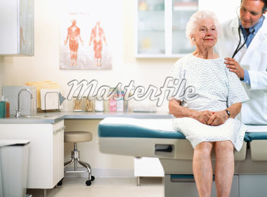 Male doctor using stethoscope on senior woman's back Stock Photo - Premium Royalty-Freenull, Code: 613-01521694