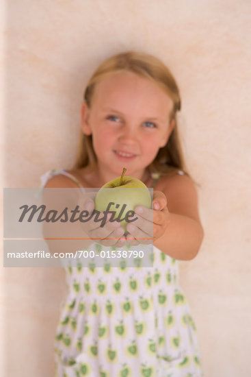 Child Holding Apple    Stock Photo - Premium Rights-Managed, Artist: Marie Blum, Code: 700-01538790