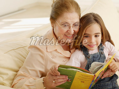 Grandmother reading a storybook to granddaughter Stock Photo - Premium Royalty-Freenull, Code: 635-01594148