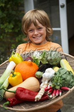 Boy Holding Tray of Vegetables    Stock Photo - Premium Royalty-Free, Artist: Masterfile, Code: 600-01616970