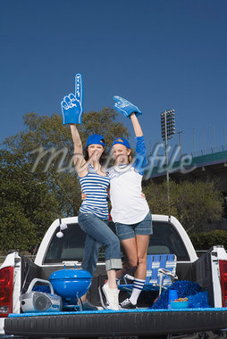 Cheering tailgating women Stock Photo - Premium Royalty-Freenull, Code: 621-01618931