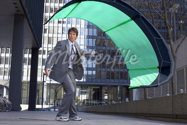 Businessman Holding Parafoil    Stock Photo - Premium Royalty-Free, Artist: Jerzyworks, Code: 600-01630172