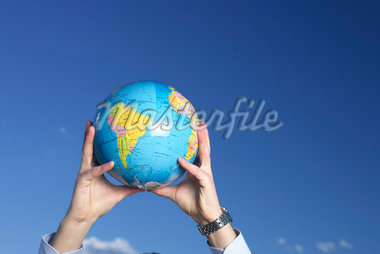 Businessman holding globe up Stock Photo - Premium Royalty-Freenull, Code: 628-01639054