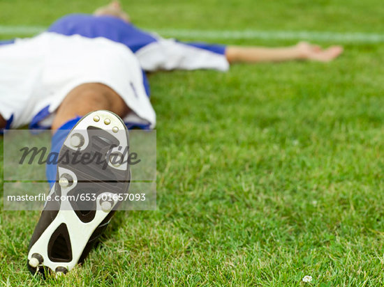 A soccer player lying down