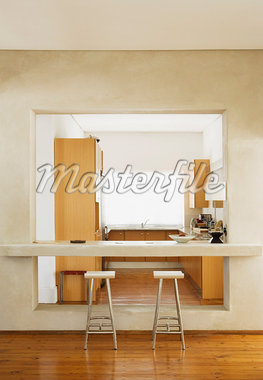 Modern kitchen with stools Stock Photo - Premium Royalty-Freenull, Code: 635-01705567