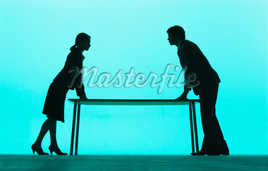 Businessman and businesswoman at a table Stock Photo - Premium Royalty-Freenull, Code: 635-01706354