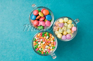 High angle view of three cups filled with jellybeans and candies Stock Photo - Premium Royalty-Freenull, Code: 630-01709484