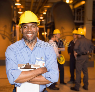 Smiling manager wearing hardhat Stock Photo - Premium Royalty-Freenull, Code: 604-01742483