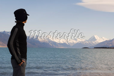 Man Looking over Lake and Mountains, Lake Pukaki, Mount Cook, Canterbury, New Zealand    Stock Photo - Premium Rights-Managed, Artist: Lalove Benedict, Code: 700-01765146