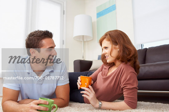 Couple Drinking Coffee in Living Room    Stock Photo - Premium Rights-Managed, Artist: Artiga Photo, Code: 700-01787712