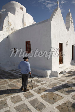 Man Standing by Church, Mykonos, Greece    Stock Photo - Premium Rights-Managed, Artist: Derek Shapton, Code: 700-01827227