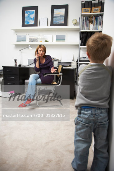 Woman Annoyed at Child Interrupting Phone Call    Stock Photo - Premium Rights-Managed, Artist: Masterfile, Code: 700-01827613