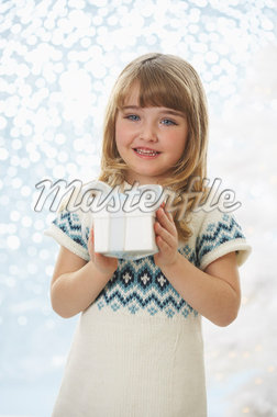 Portrait of Girl Holding Present    Stock Photo - Premium Royalty-Free, Artist: Masterfile, Code: 600-01838465