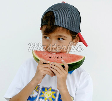 Boy biting into a slice of watermelon Stock Photo - Premium Royalty-Freenull, Code: 659-01856089