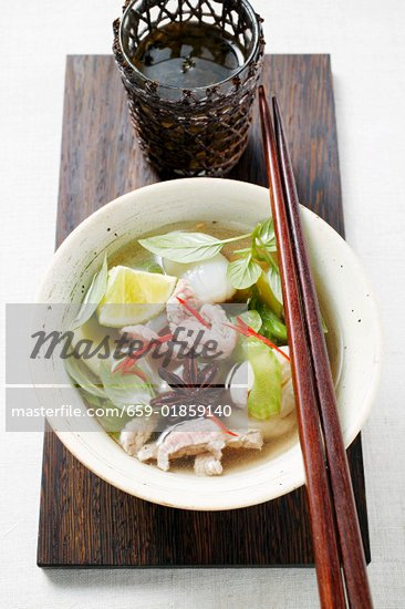 Chicken and lemon grass soup with lime, Thai basil (Asia) Stock Photo - Premium Royalty-Freenull, Code: 659-01859140