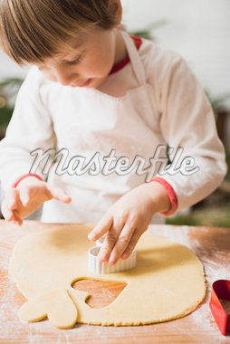 Small boy cutting out biscuits Stock Photo - Premium Royalty-Freenull, Code: 659-01861839