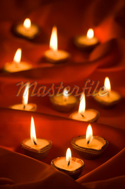Group of burning oil lamps Stock Photo - Premium Royalty-Freenull, Code: 630-01877619