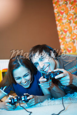 Couple Playing Video Games    Stock Photo - Premium Royalty-Free, Artist: Masterfile, Code: 600-01879512